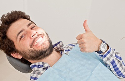 man smiling thumb up