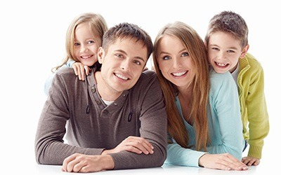 Smiling family against a white background