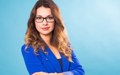 Professional woman against blue background