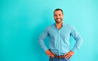 Man in front of blue background