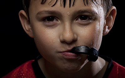 Young boy with athletic mouthguard