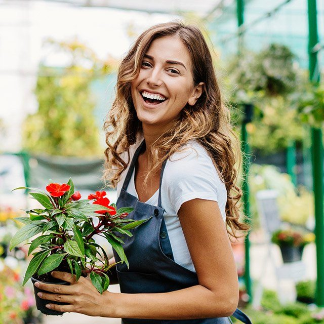 Laughing woman in green house